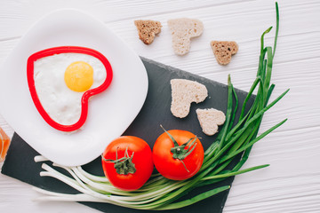 valentine day.romantic breakfast.Fried eggs with vegetables