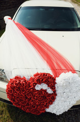 White and red heart on the wedding car