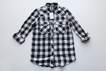 checkered shirt with price tag on white background
