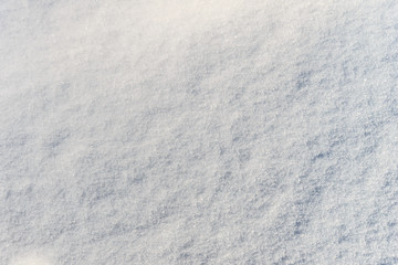 Snow texture at sunny winter day. Abstract background.