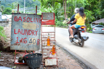 Gasoline for sale at a roadside stall on Koh Chang, Thailand