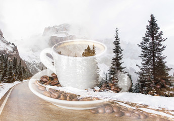 Double exposure of cup of coffee and winter mountain road