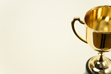 gold winner cup on yellow background