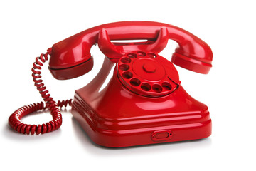 Red retro telephone on white background