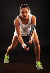 Female tennis player in split step position.