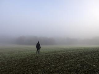 Man standing in a foggy field, Spain