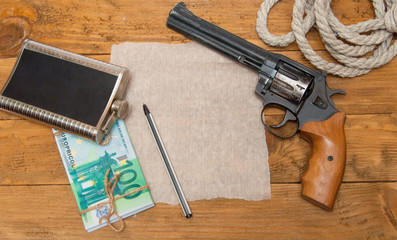 flask, gun, rope, money is on Board, place for text.