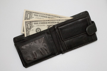dollars in wallet on white background
