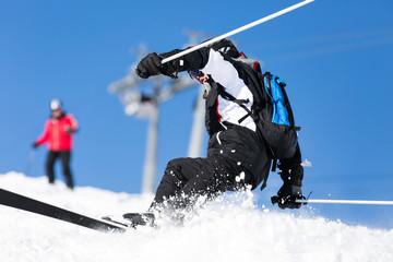 Male skier crashes