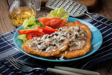 Crispy fried homemade potato pancakes with mushroom sauce.