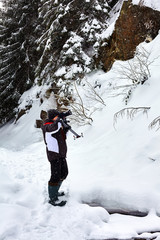 Landscape photographer on winter time