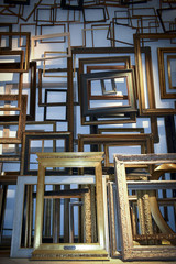 A large amount of empty picture frames in a flat