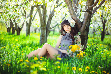delicate and beautiful woman to spring flowering gardens