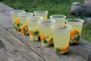 Fish soup in a glass on the table