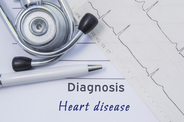 Diagnosis of Heart disease. Stethoscope, printed electrocardiogram and pen are on paper medical form where indicated cardiological diagnosis Heart disease. Concept for Internal Medicine or Cardiology