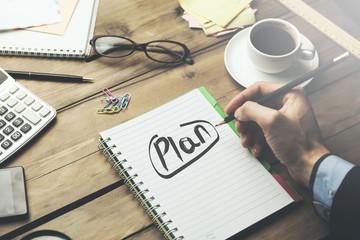 man written plan text on notebook on desk - fototapety na wymiar