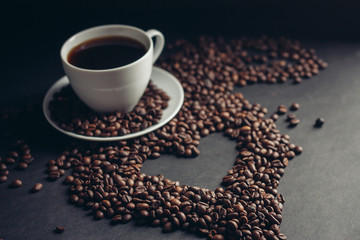 cup with a drink on coffee beans, a heart