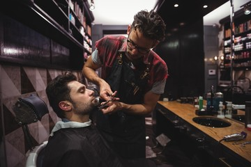 Man getting his beard trimmed with scissor
