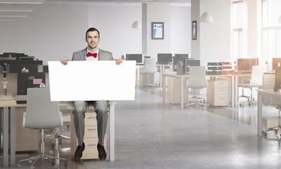 Businessman show white banner . Mixed media