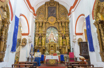 CORDOBA, SPAIN - MAY 26, 2015: The carved baroque main altar in Church Eremita de Nuestra Senora del Socorro by Alfonso Gomes de Sandoval from 17. cent.