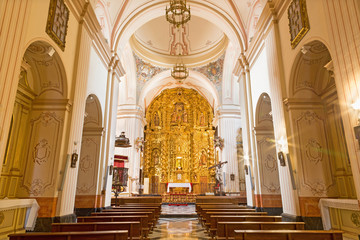 CORDOBA, SPAIN - MAY 26, 2015: The nave of church of Monastery of st. Ann and st.Joseph (Convento de Santa Ana y San Jose) with the main altar by Sanchez de Rueda (1710).