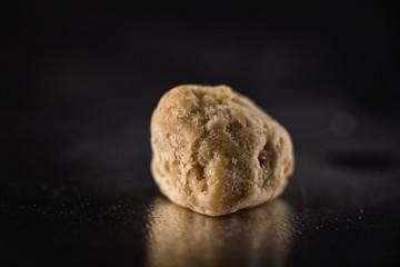 Macro of marijuana extraction concentrate aka wax crumble on dar