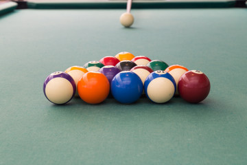 Cue aiming white ball to break snooker billards on table