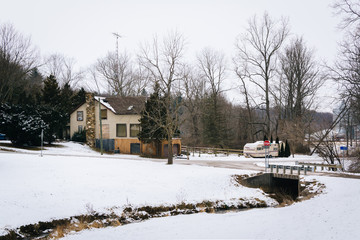 Creek in a snow covered field and house, near Glenville, Pennsyl