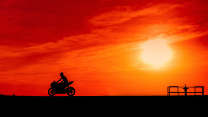 silhouette Motor bike on a road in the sunset