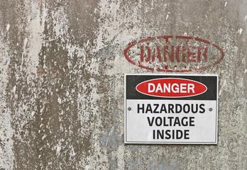 red, black and white Danger, Hazardous Voltage Inside warning sign