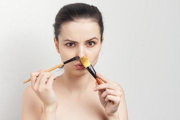 brushes near the face of women