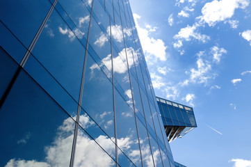 Glass office building in Barcelona - concept of business and financial