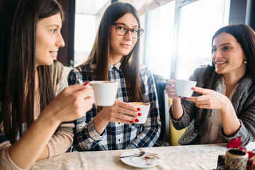 Young women frineds enjoy in coffee in coffee shop