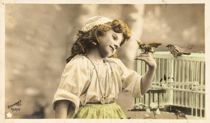 Printed kitchen splashbacks Painterly Inspiration Carte postale ancienne / Enfant et l'oiseau en cage