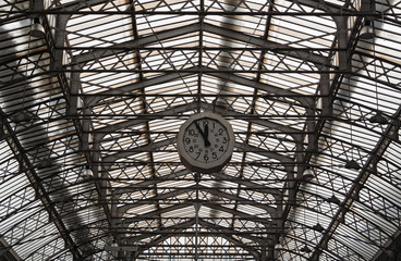 Roof structure of the Paris railway station Gare de l'Est with clock, France