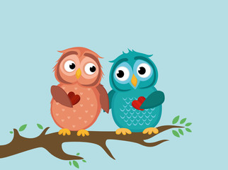 A pair of cute owlet sitting on a branch. Owls in love hold hearts