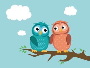 A pair of cute owlet sittinA pair of cute owlet sitting