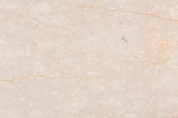 Seamless beige marble stone tile texture.