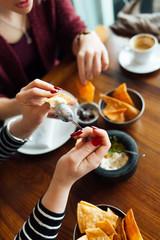 Women eating in restaurant