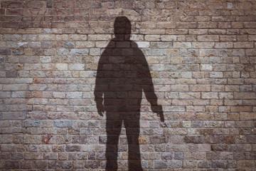 shadow of a man holding his gun