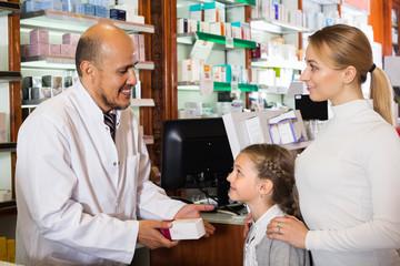 Pharmacist helping customers