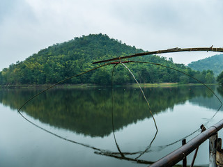 Large squre dip net in beautiful tranquil lake and mountain back