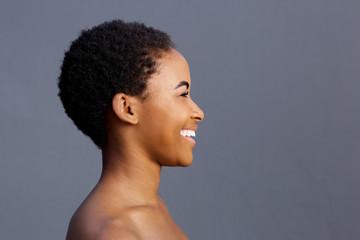 beautiful smiling black female model against gray background