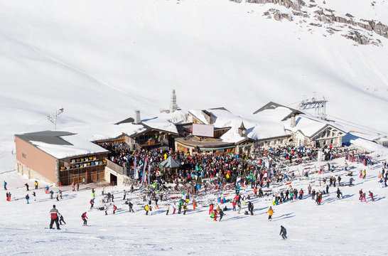 Party in mountain restaurant on the snowy slope at the ski resor