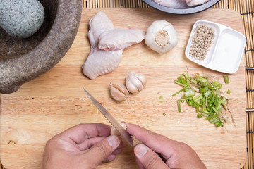 Chef peeling garlic with knife
