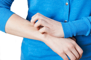 Close Up Of Woman Scratching Arm