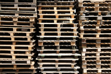 Stacked wooden pallets in an outdoor storage