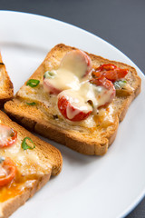 Grilled toast with camembert and cherry tomatoes
