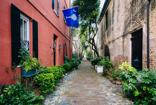 Narrow cobblestone street and old buildings in Charleston, South