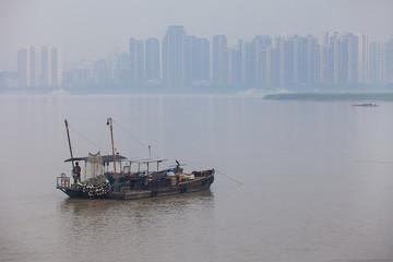 a ship in ou river, haze, fog, bad air condition